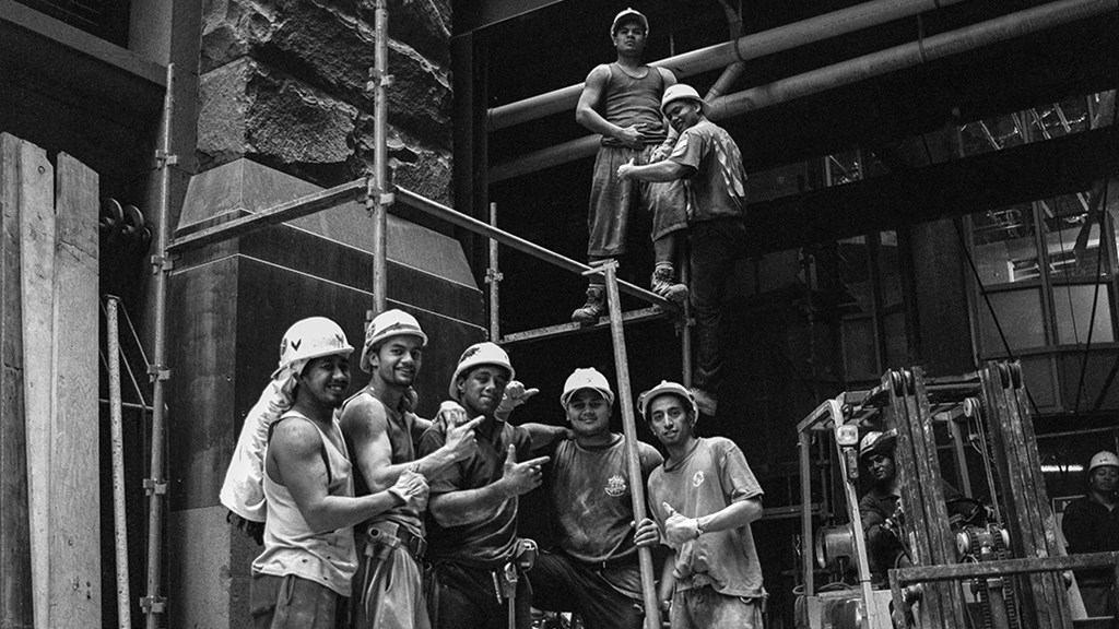 A black and white image of construction workers posing at the site of City Recital Hall. Image courtesy of City of Sydney Archives, Tim Cole Collection.